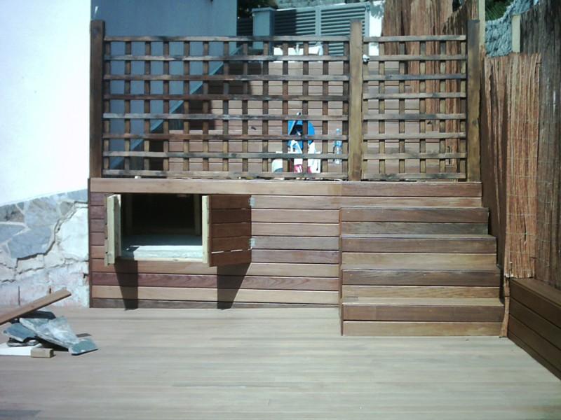 Tarima de exterior con ipe en terraza con piscina en for Piscina sitges